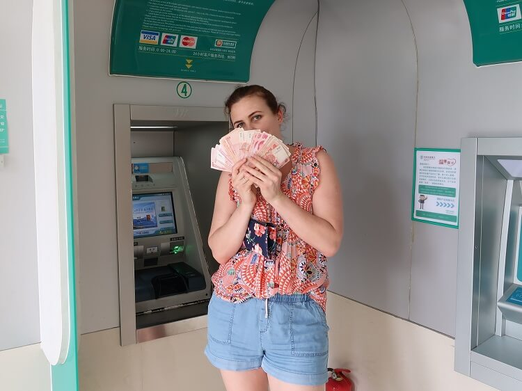 Foreigner withdrawing money at Chinese ATM