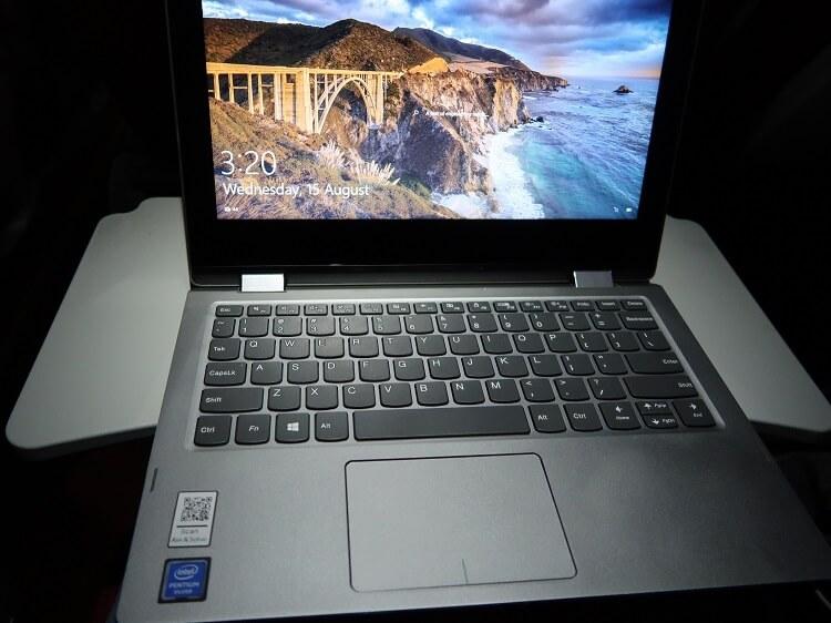 Laptop on flight tray table