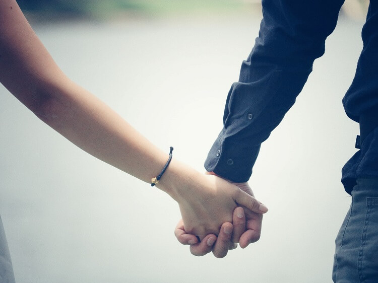 Couple holding hands - dating in China