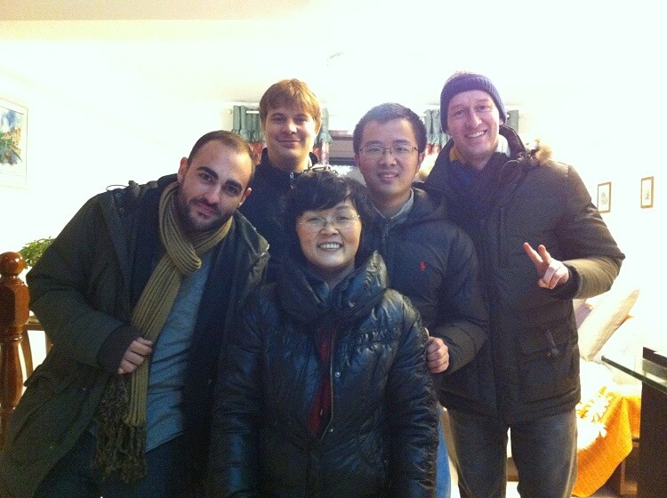 Group of foreign travelers with Chinese people