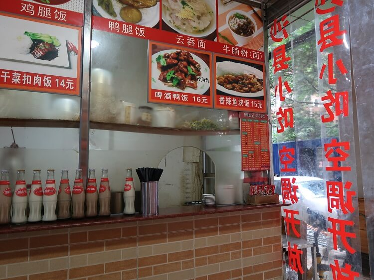 Chinese restaurant with picture menu on wall