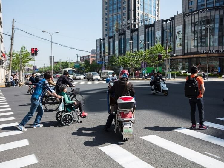 Walking across a pedestrian crossing in China