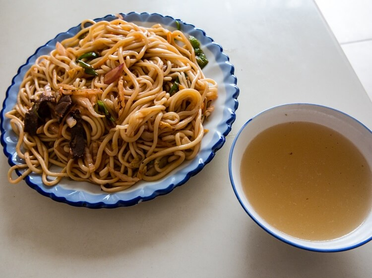 Noodles and bowl of soup