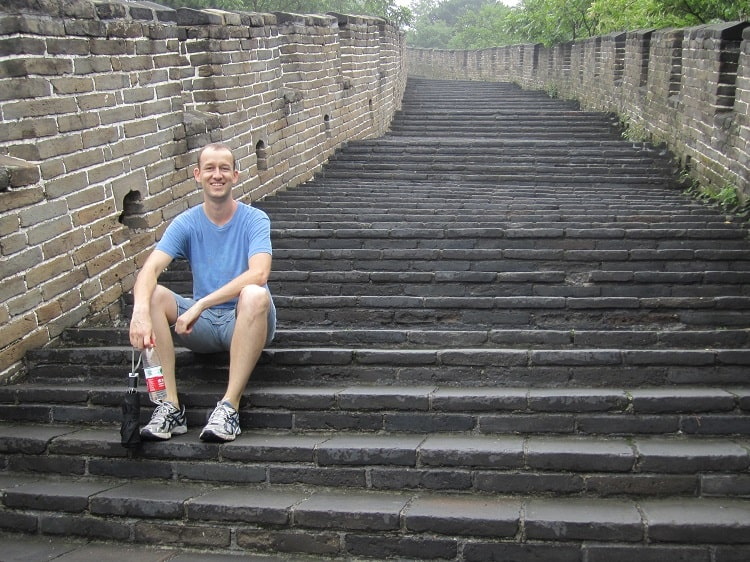 Tourist on steps of Great Wall Beijing