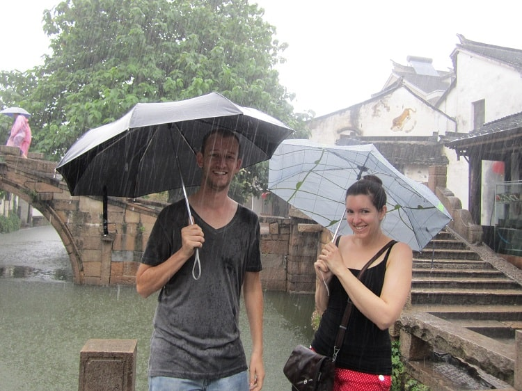 Tourists holding umbrellas in Water Town