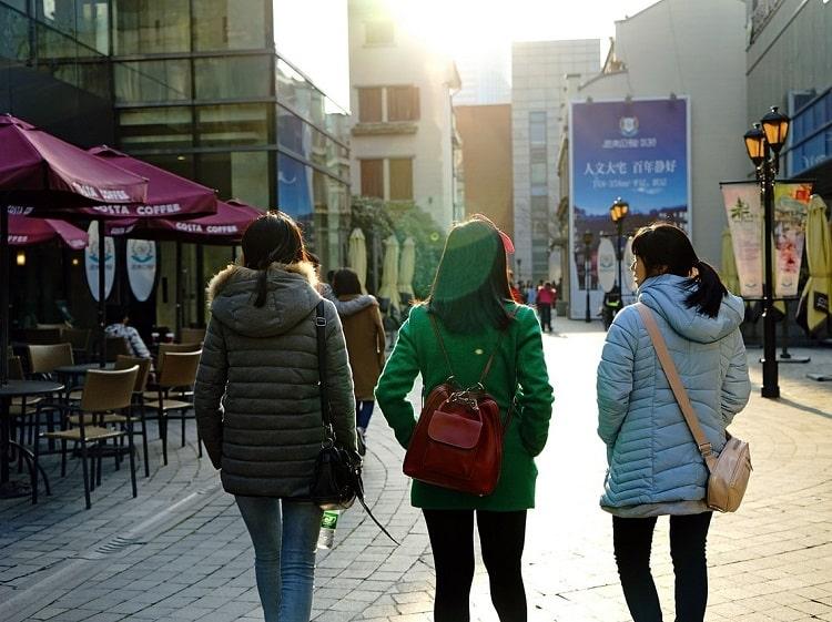 Chinese girls on a street walking away