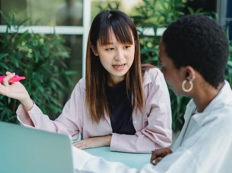 Two women in Chinese-English language exchange