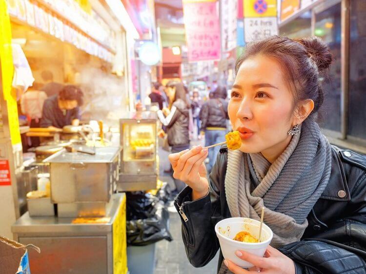 Beautiful Chinese girl eating dumplings