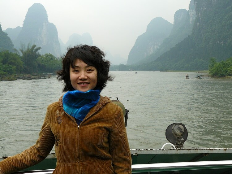 Smiling Chinese woman on boat
