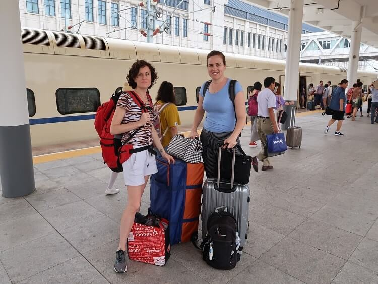 Foreign women with luggage in China