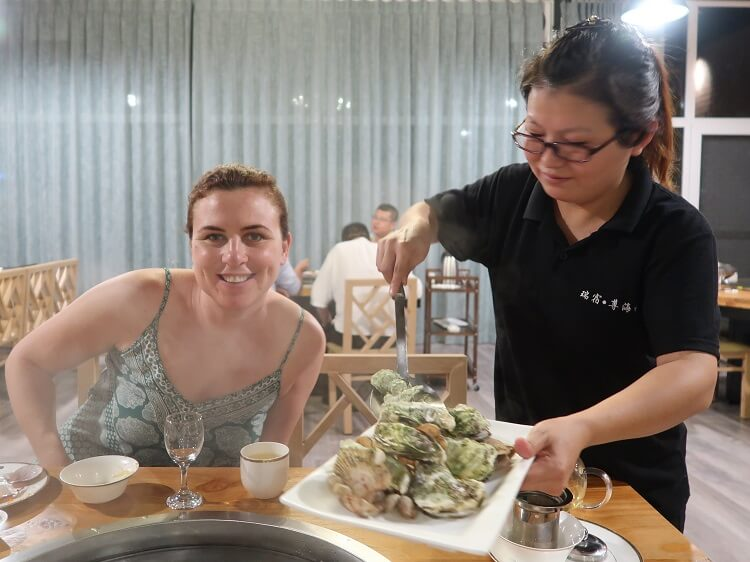 Foreign woman being served food in China