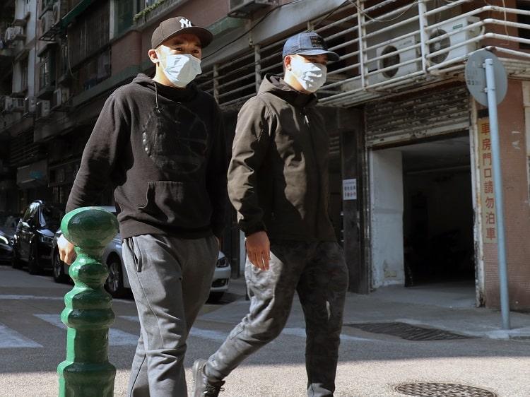 Chinese men wearing face masks